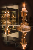 Mirror candles Stock Photos