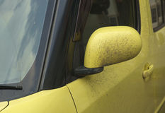 Mirror of car. Dirty yellow mirror of car Royalty Free Stock Image