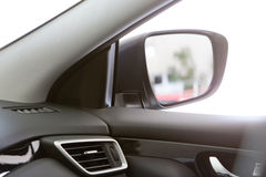 Mirror on the car. Look in the side mirror on the car Royalty Free Stock Images
