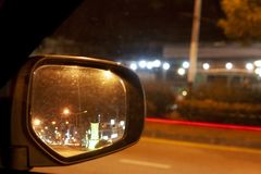 Mirror car on night. Car on the road on night view from mirror of beside car with light speed of car on the road stock image
