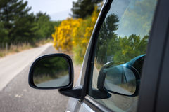 Mirror of the car with the road Stock Photo