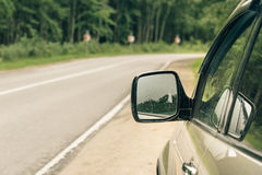 Mirror of a car on the road background Royalty Free Stock Photos