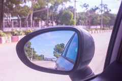 Mirror car on street driving stock images