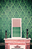 Mirror on chimney in room with vintage retro pattern wall Royalty Free Stock Photography