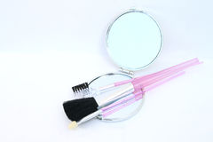 Mirror and cosmetic tools Stock Photo