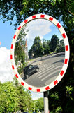 Mirror in cross street for improving visibility Stock Photography