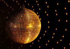 Mirror Disco Ball. Mirror/disco ball reflecting yellow spotlight against black background Stock Photos