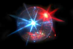 Mirror disco ball. With laser lights reflecting off in blue and red on a dark background Royalty Free Stock Images