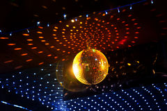 Mirror disco ball with light reflection on the ceiling Stock Photography