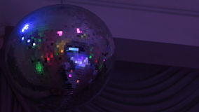 Mirror disco ball with light reflection on the ceiling stock video