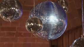 Mirror disco balls on a party stock video footage