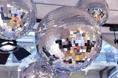Mirror disco balls and a searchlight on a New Year`s background stock image