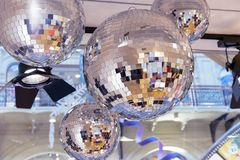 Mirror disco balls and a searchlight on a New Year`s background royalty free stock images