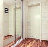 Mirror door interior. Interior corridor with closed door reflection in a wall mirror stock image