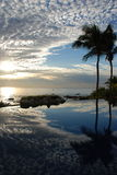 Mirror effect in endless pool Los Cabos 2. Sunrise with light cloud cover mirrored in pool royalty free stock image