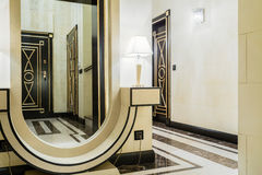 Mirror in entrance hall. Big extravagant mirror in new modern entrance hall Royalty Free Stock Images
