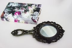 Mirror from a fairy tale. mirror and book stock photo