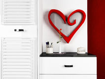 A mirror in a form of the heart Stock Images