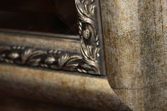 Mirror and Frame. This photograph features the corner of a frame for a mirror. The texture and color of the frame is fantastic and matches the image well Royalty Free Stock Photography