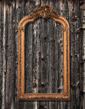 Mirror frame on a wooden wall Stock Images