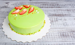 Mirror glaze mousse cake with strawberries and pistachios Royalty Free Stock Photography