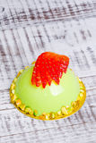 Mirror glaze mousse cake with strawberries and pistachios Royalty Free Stock Images