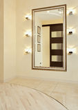 Mirror in golden frame in beige anteroom Royalty Free Stock Photos