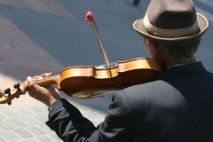 Mirror of heart. Gipsy who play violin on the street Stock Image