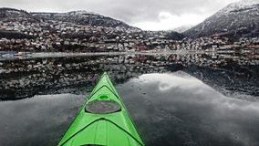 Mirror, ice and views of Ulriken mountain in Bergen royalty free stock image