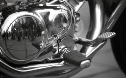A mirror image in a motorcycle engine stock photography