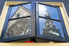Mirror image St. Stephens Church in kitchen window. Netherlands, Gelderland, Nijmegen: still life of a part of the St. Stephen`s Church and St. Stevens Tower Royalty Free Stock Image