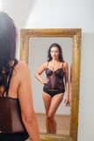 Mirror image of a woman in lingerie Stock Photo