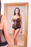 Mirror image of a woman in lingerie Stock Image