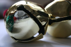 Mirror Images. Sleigh bells with reflection of holiday chrismtas balls in side stock photography