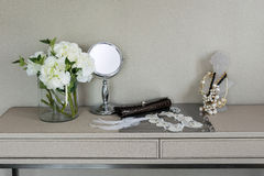 Mirror,jewelry and makeup set on a table Royalty Free Stock Images