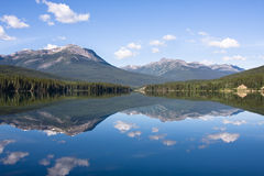 Mirror Lake. A mountain landscape is perfectly reflected in the water of Lake Yellowhead,  Canada Stock Photography