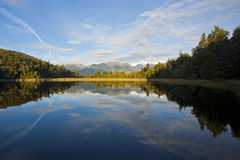 Mirror Lake. Reflection in Lake Matheson, New Zealand Stock Images