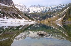 Mirror lake in alps Royalty Free Stock Photos