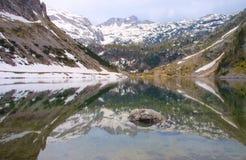 Mirror lake in alps Royalty Free Stock Photos