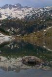 Mirror lake in alps Stock Image