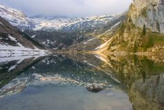 Mirror lake in alps Stock Photography