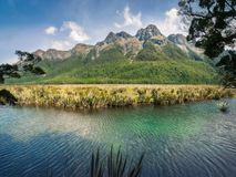 Mirror Lake in Fiordland National Park, New Zealand. Mirror Lake with the mountain range in the background in Fiordland National Park, New Zealand, South Island Stock Image