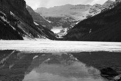 Mirror lake. Frozen Lake Louise in the Rocky Mountains, Banff National Park, Alberta, Canada Stock Images