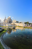 Mirror lake inside public white temple with clear sky background Stock Images