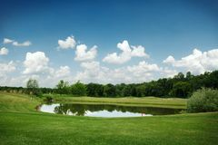 Mirror lake, lawn for golfing on golf course. Mirror lake, trimmed lawn and sand bunkers for golfing on golf course, nobody. Meadow in sport club, playground stock photos