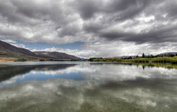 Mirror lake in New Zealand stock photography