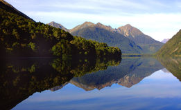 Mirror Lake, New Zealand. Mirror Lake at Milford Sound on a clear day Royalty Free Stock Photo