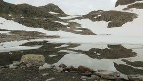 Mirror lake in the Norwegian mountains stock video