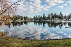 Mirror Lake Reflection 2. Homes, trees and sky are reflected in the water of Mirror Lake in Federal Way, Washington Royalty Free Stock Images