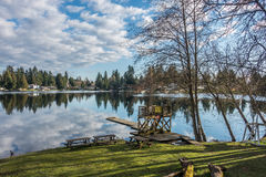 Mirror Lake Reflection 4. Homes, trees and sky are reflected in the water of Mirror Lake in Federal Way, Washington Stock Images